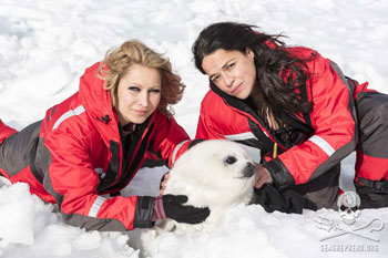 Yana Watson and Michelle Rodriguez with harp seal pup